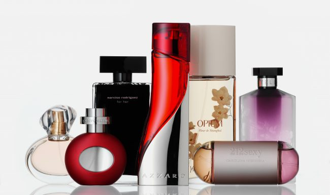 Perfumes cosmetics group of parfum bottles white back ground reflection on the underground scents