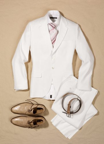 business Summer Outfits with white suit brown shoes and belt lying on sand set design