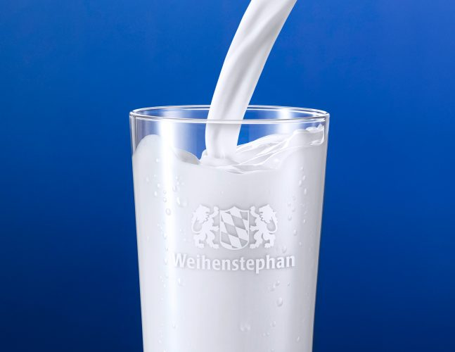 dairy food liquids milk pouring in to glas high speed photography blue background packaging image