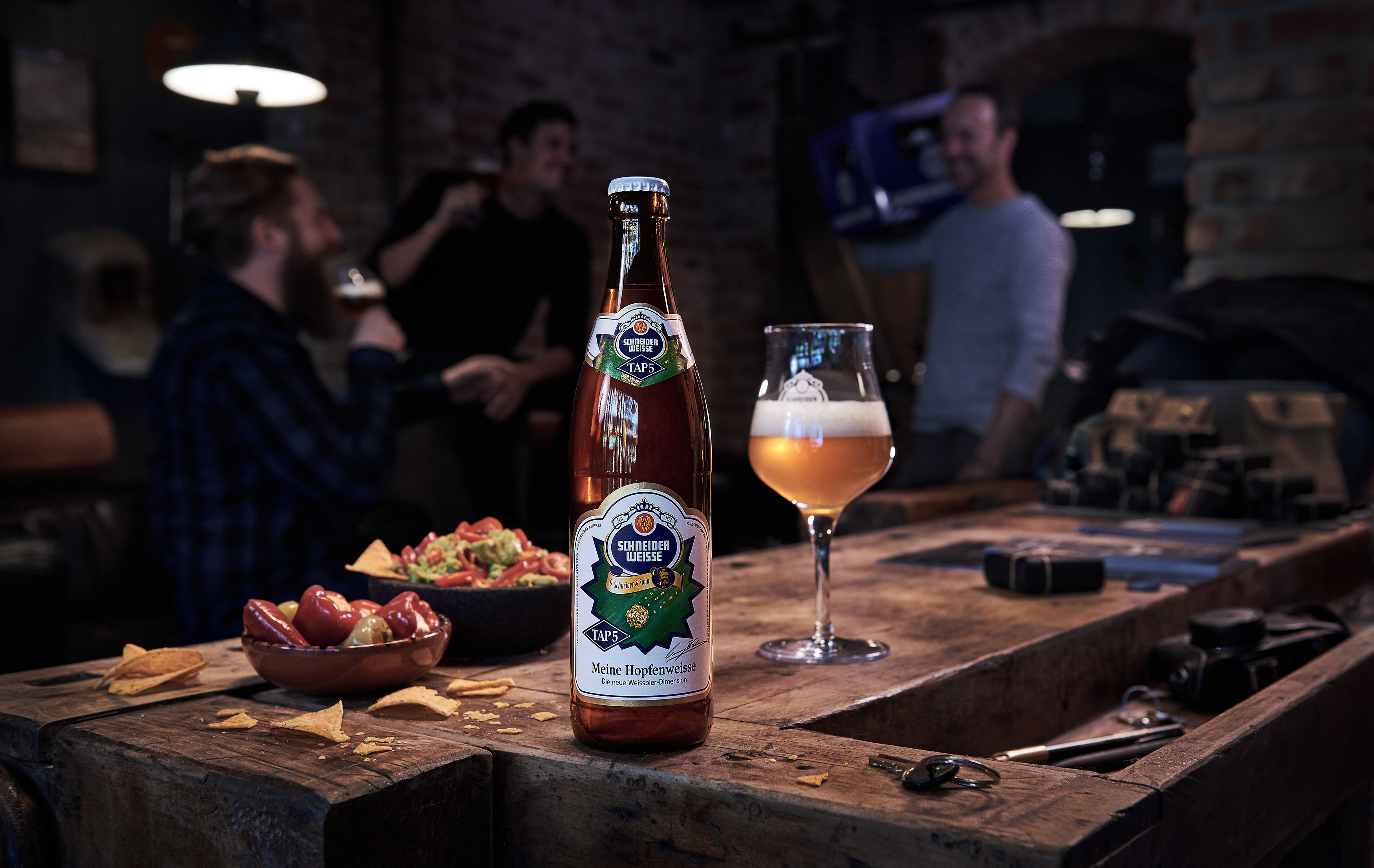 hopfenweisse wheat beer in loft with people drinking beer