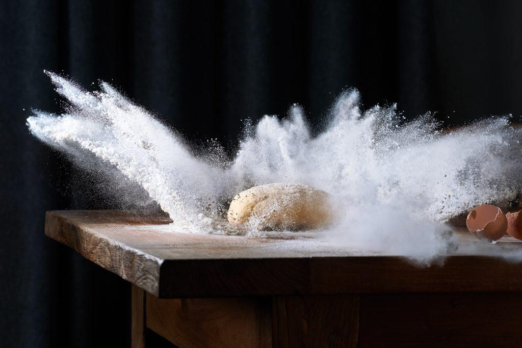 dough hits flour flour expoldes high speed photography