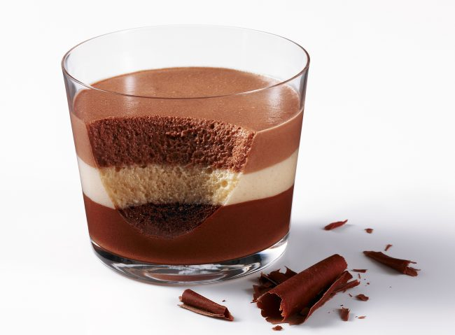 Chocolate Mousse triple in a glas with chocolate flakes