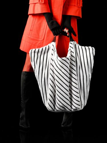 woman with striped handbag red coat black boots people stills zoeppritz accesories