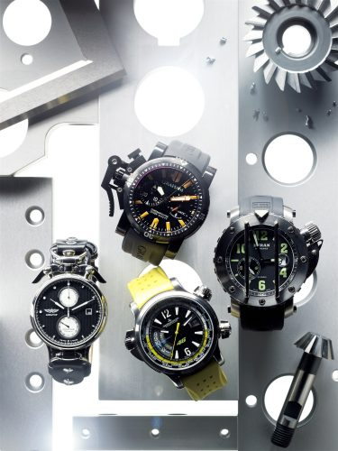watches still life shot in front of technical drilled steel for playboy magazine backlight