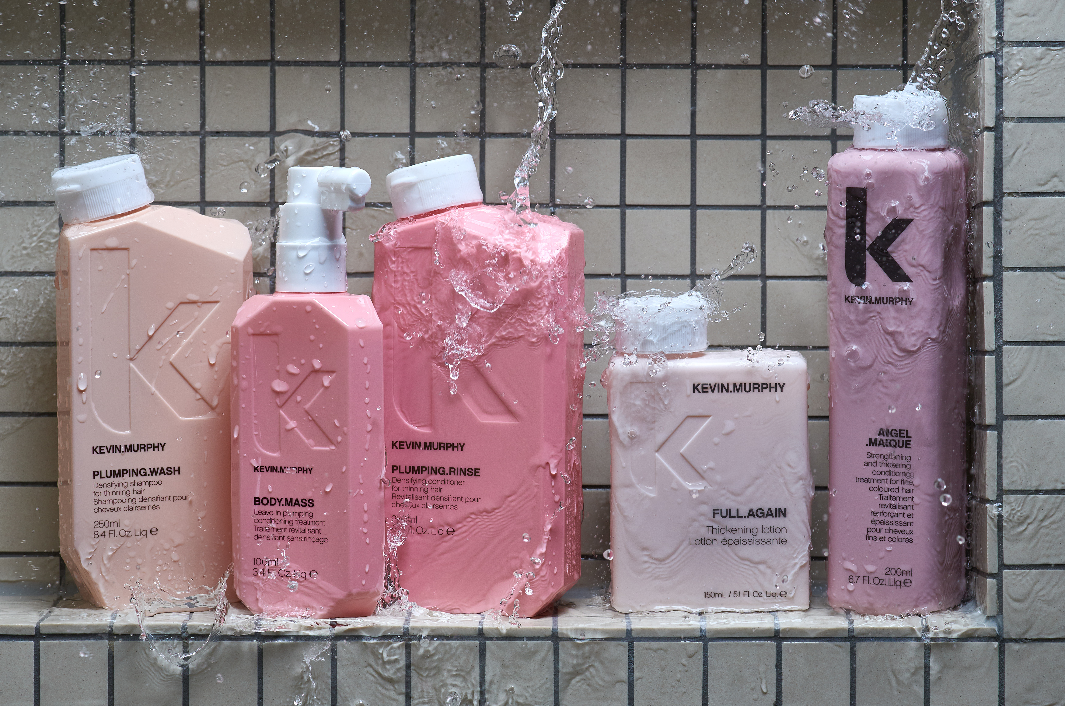 styling products from kevin murphy standing in a shower niche photo location, water expoding watterdrops