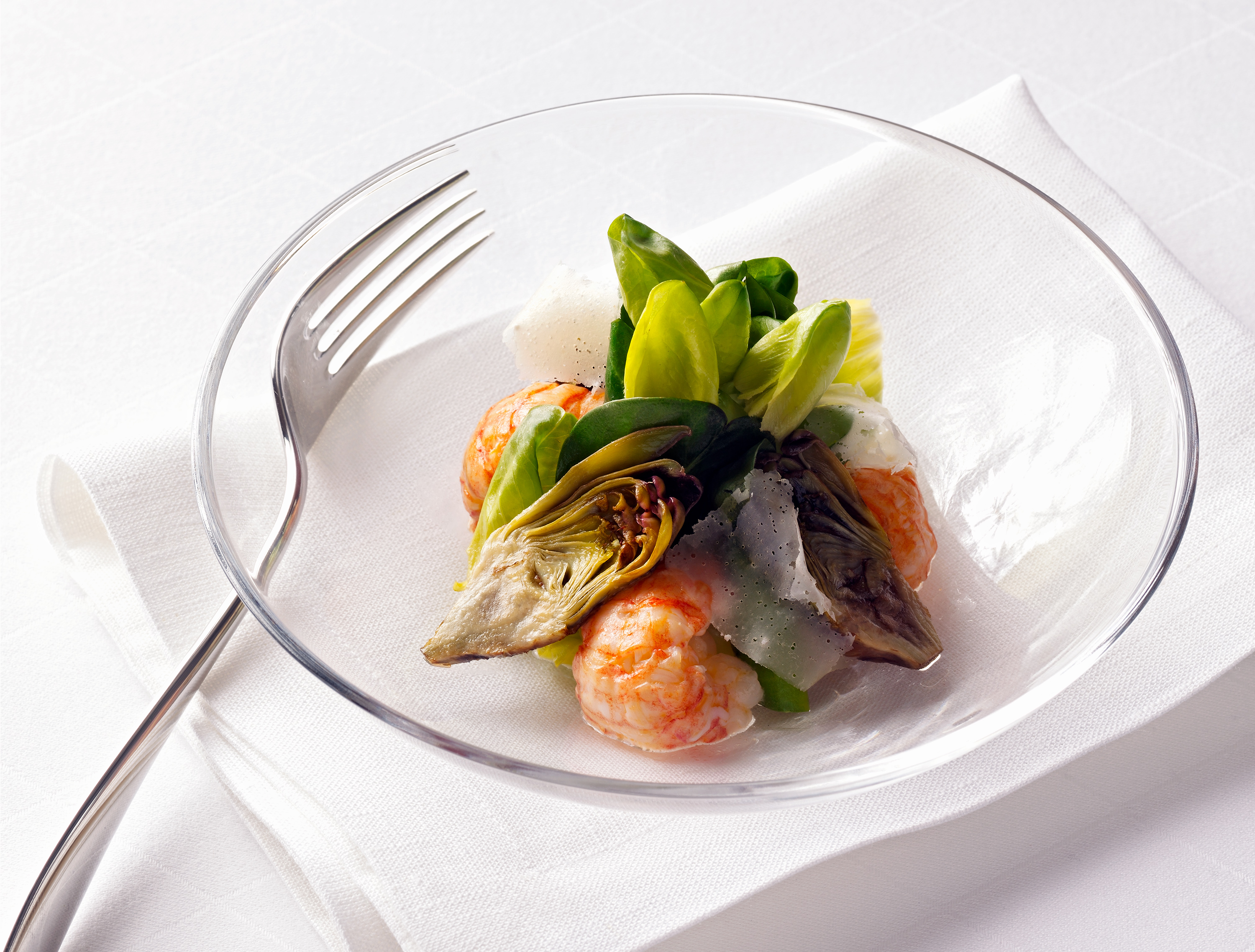 packaging shots of a dinner with seafood salad in a glass bowl