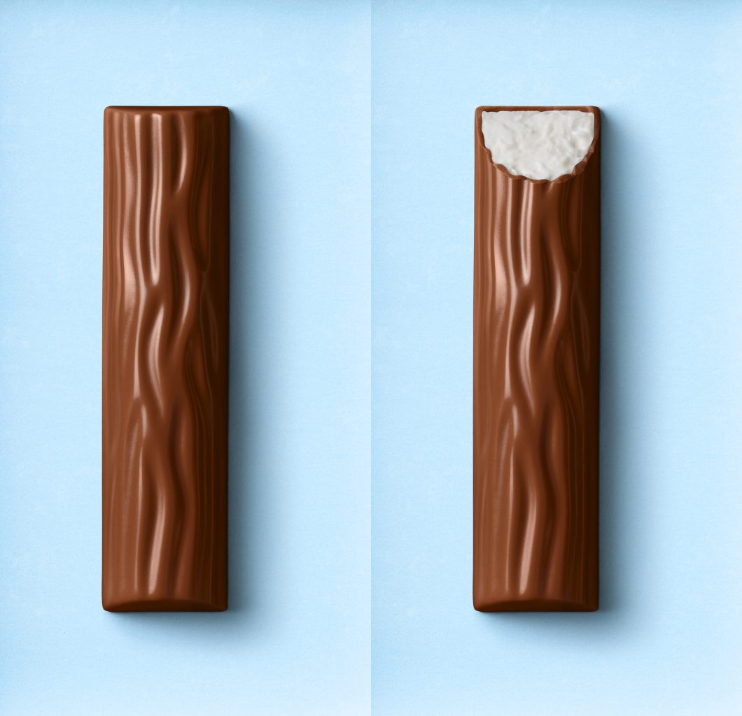 Packaging relaunch for the yogurt packaging. A bitten Yoguretten Yogurt Sensation chocolate bar and an unbitten white chocolate bar lie on a blue background
