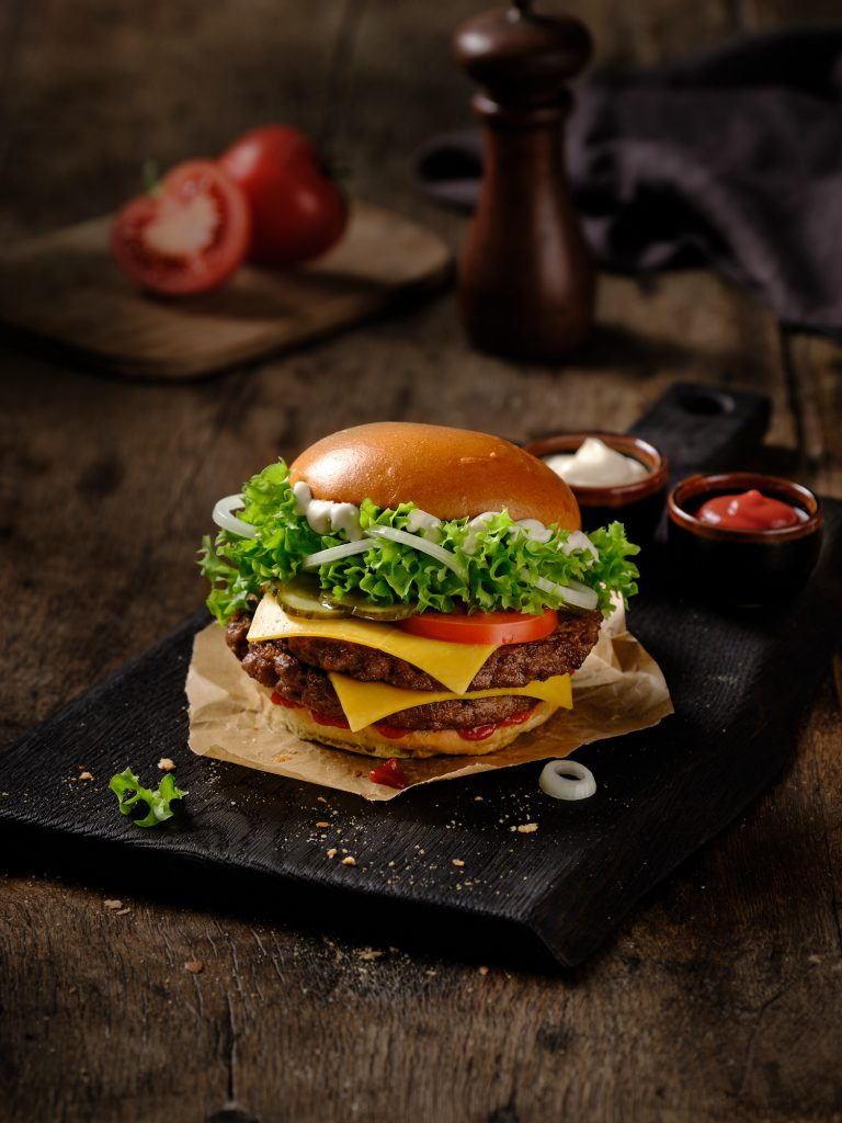 freshly prepared Burger Double Classic is in a nice seting with ingredients